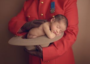 newborn-boy-photographer-fraser-valley-vancouver-hope-chilliwack-red-serge-police-pose-prop-kamloops.jpg