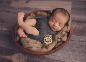 newborn-boy-photographer-fraser-valley-vancouver-hope-chilliwack-red-serge-police-pose-prop-kamloops-badge-bowl-hilary.jpg