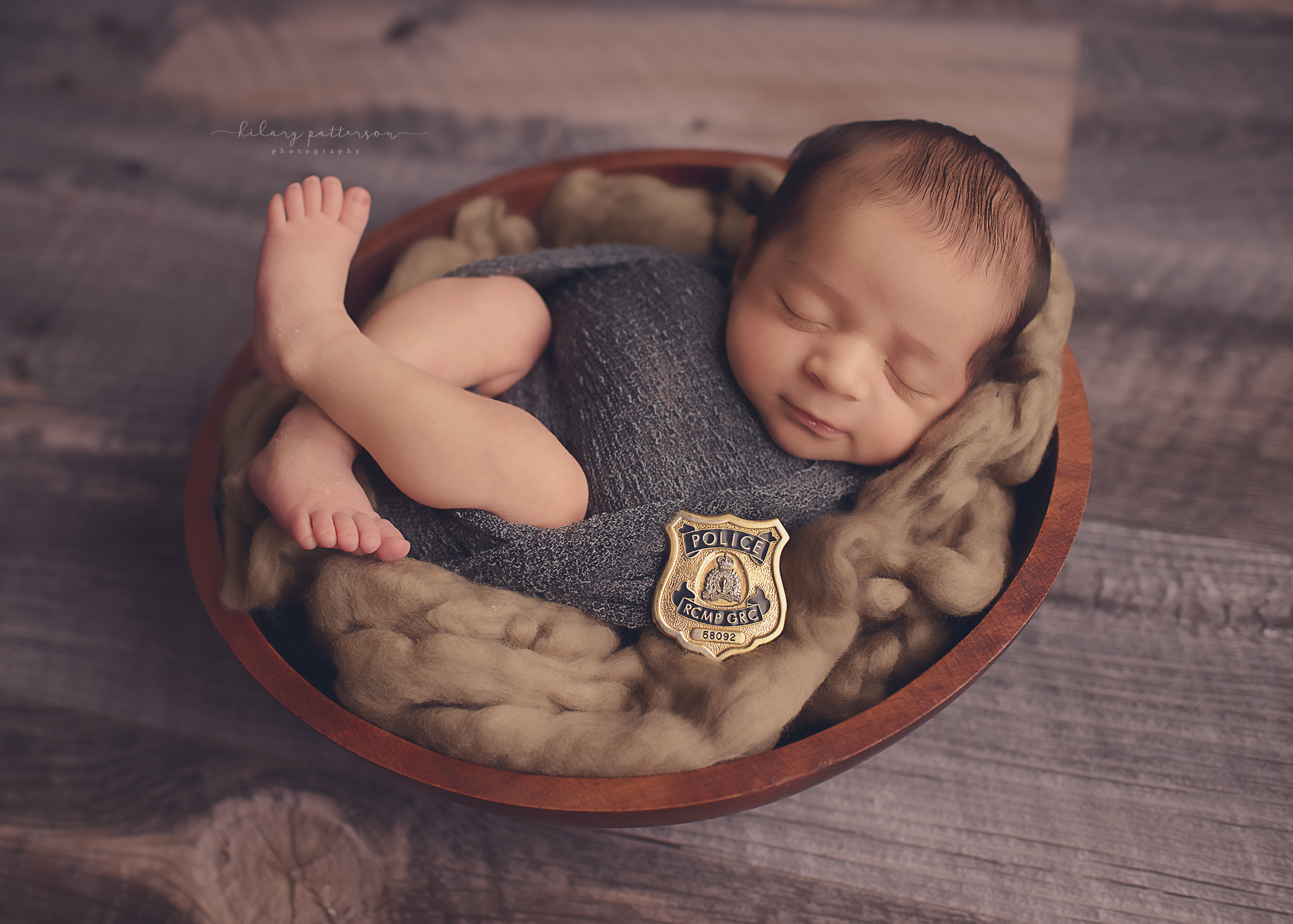 Newborn photography newborn boy photographer fraser valley vancouver hope chilliwack red serge police pose prop kamloops badge bowl hilary